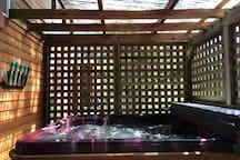 large inviting covered hot tub
