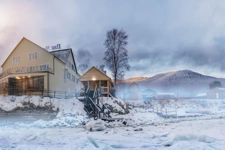 Peak Chersky. Guesthouse on Baikal.