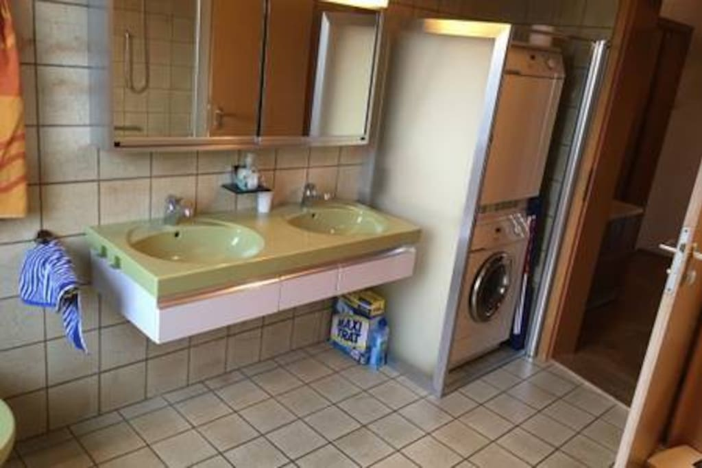 Bathroom with wash machine, drier and double sink
