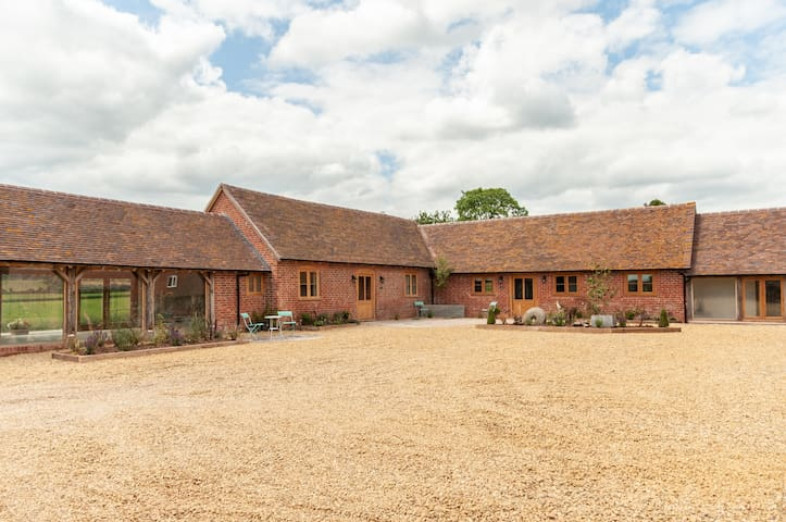 The Cowshed, luxurious barn with cosy woodburner.
