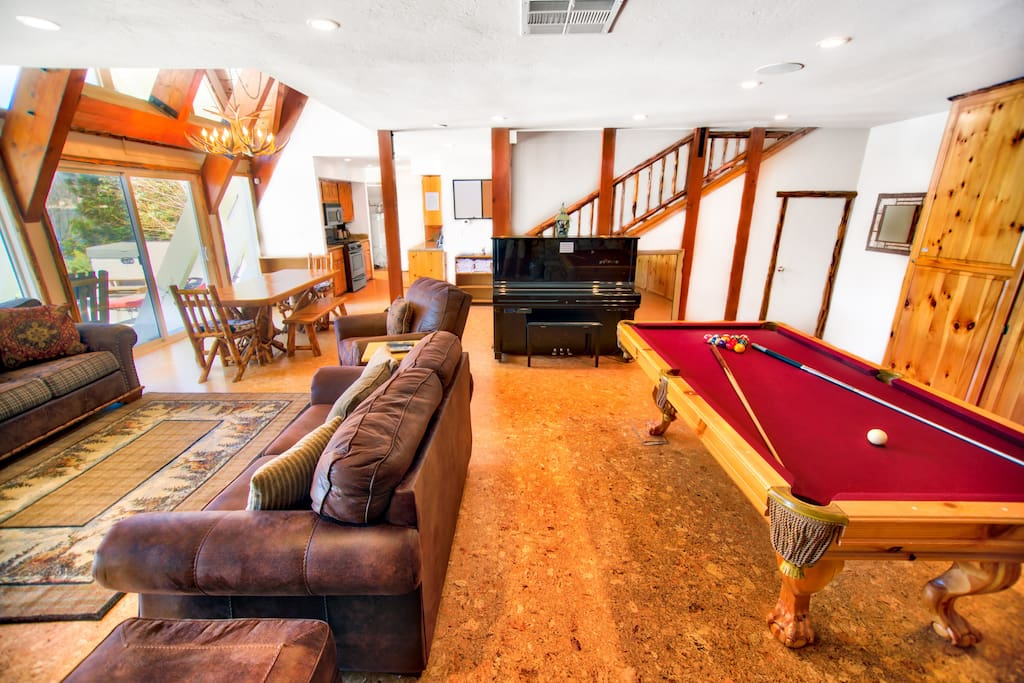 Try your hand at pool on a dramatic red table.