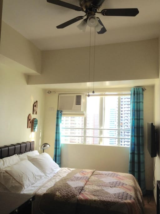 Bedroom with aircon  and flat-screen TV