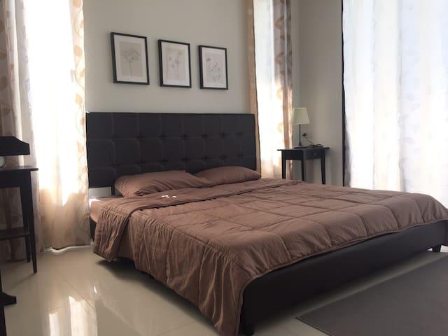 The suite bedroom is spacious, clean, airy.