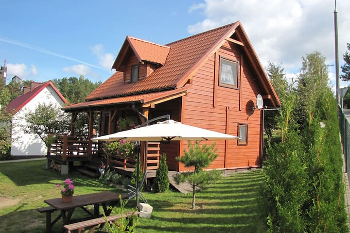 A beautiful house by the Wilkasy Lake. Living room with fireplace, terrace, 2 bedrooms