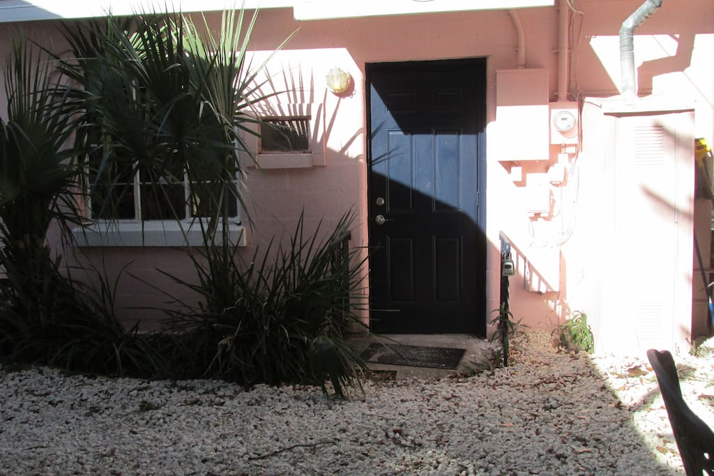 entrance.  lockbox on railing by door.  door opens out