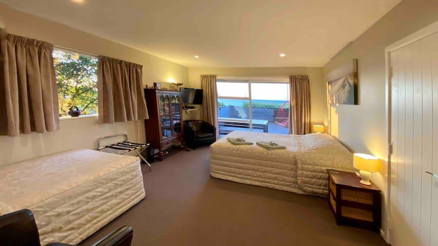 Queen and single beds in bedroom