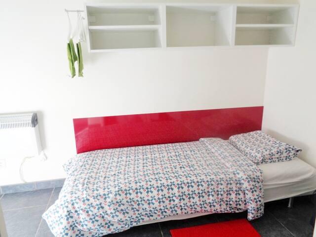 De kamer met 3 bedden
