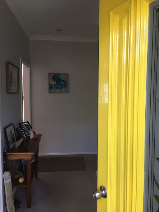 Yellow front door with screen