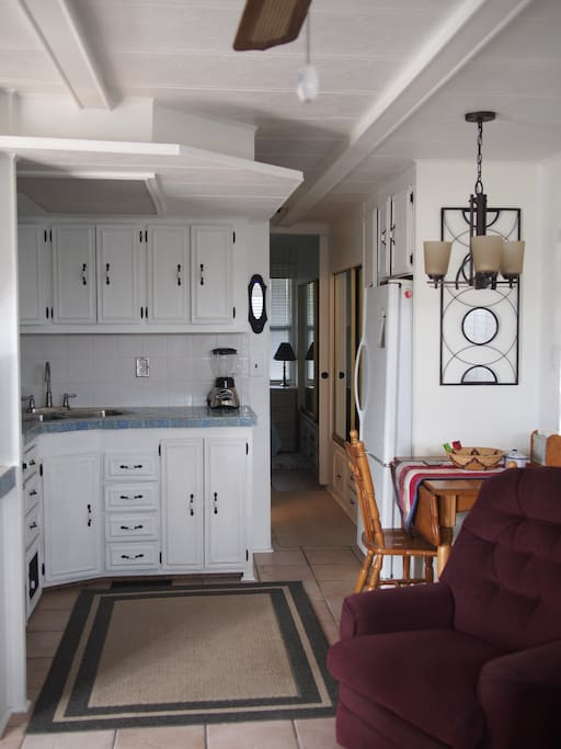 kitchen is on the left. Hallway leads to the bathroom on the left and then the bedroom