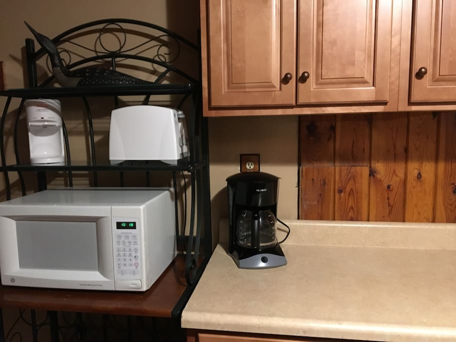 Microwave, toaster, hot shot for hot water and a coffee pot. Filters and coffee are in the cabinet.