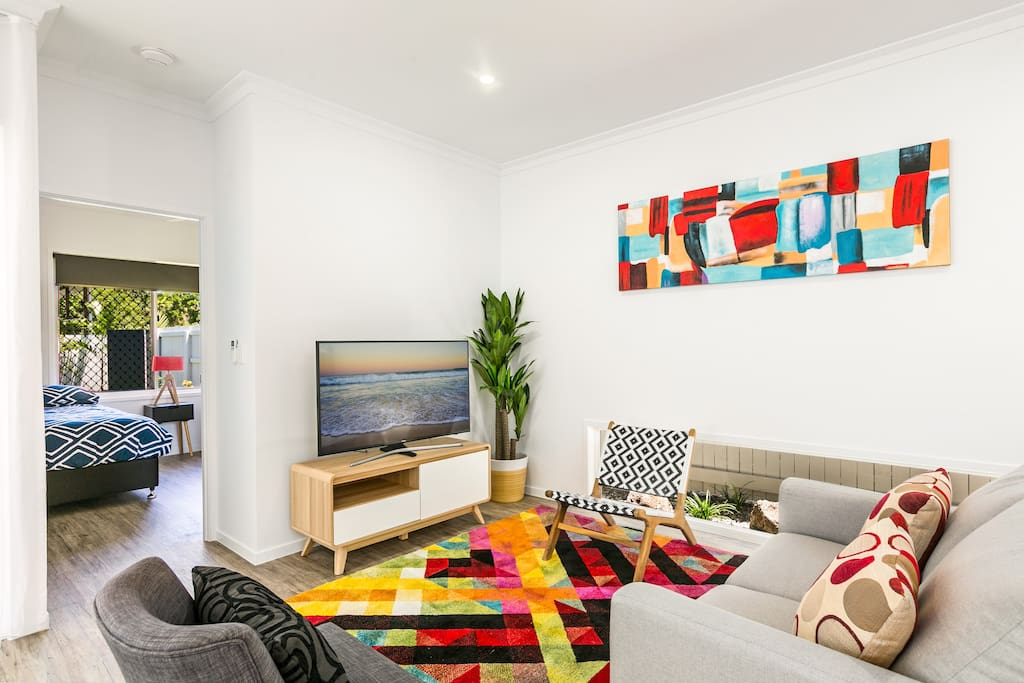 Bright and airy air conditioned living room with 50 inch smart TV