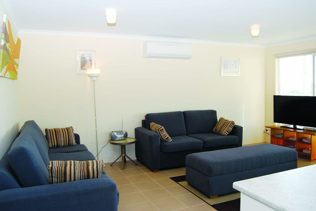 Large living area with flat screen tv, dvd player, games and magazines