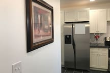 Brand new cabinets plus nice artwork on the walls make this modern home a pleasure!