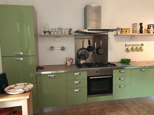 Good size fully equipped kitchen leading out to the balcony.