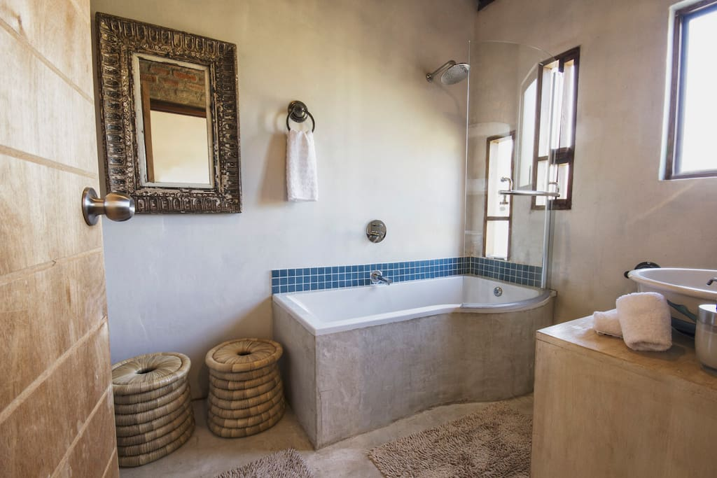 en-suite bathroom with bath/shower. baby bath available on request