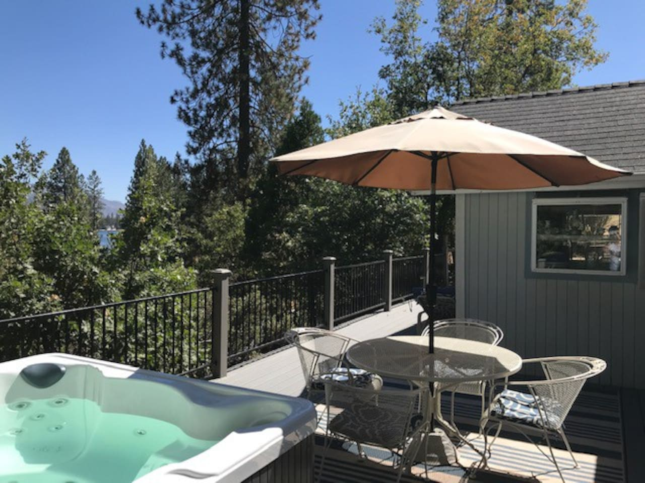 Lake can be viewed from the deck and hot tub. It's perfect for stargazing after a long day at Yosemite.