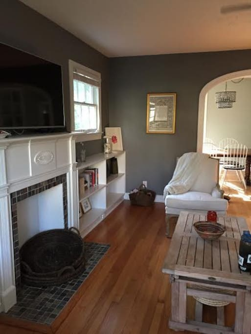 """Nice sized living room with extra long sofa & 50"""" TV. Leads to dining room."""