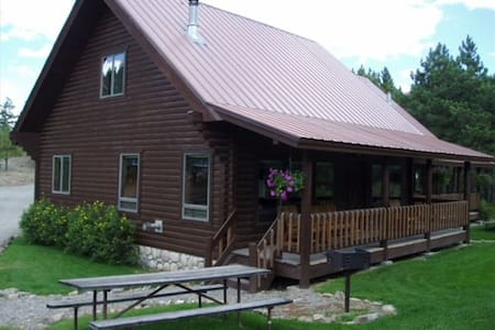 Our cabin has all the comforts of home with mountain views from a covered porch. Enjoy our spacious cabin with kind beds for your group of 6, or rent both sides of the duplex for a group up to 12. We are ¼ mile north of town within walking distance.