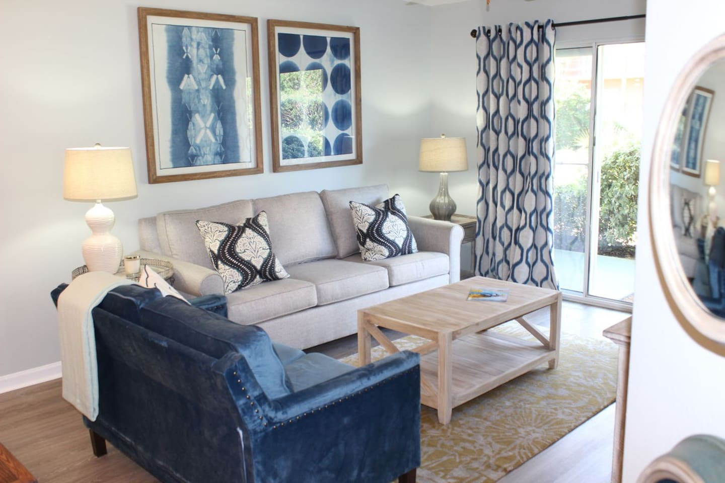 Beautifully decorated open concept living area with doors leading out to patio.