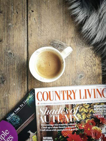 Autumn coffee time- close up of the wooden hut floor
