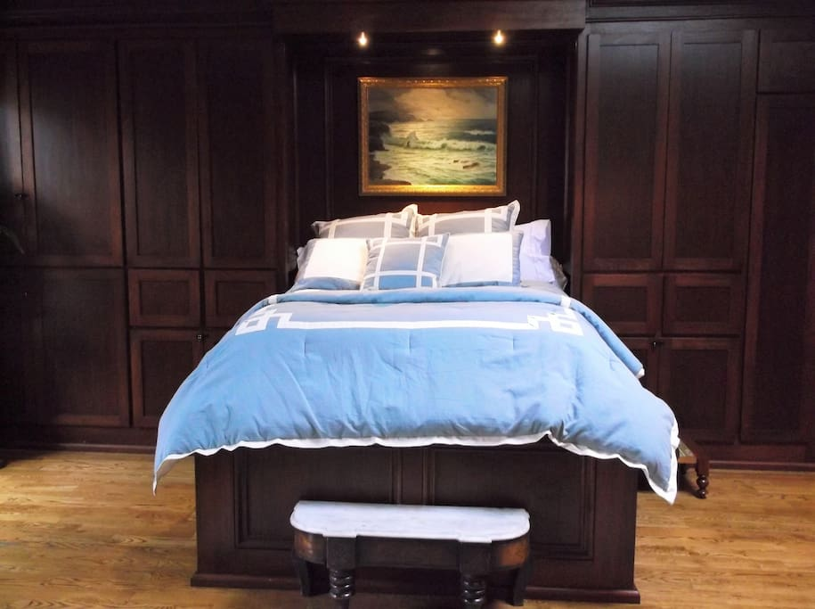 Custom built, mahogany bed with quality linens and quilted cotton blanket with designer duvet.