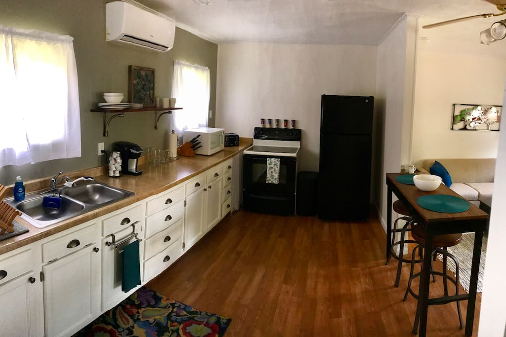 Full sized Range and Fridge. Also able to cook using Microwave and Toaster.