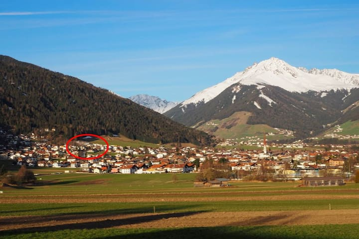 The building is located at the foot of the mountain Axamer Kögele