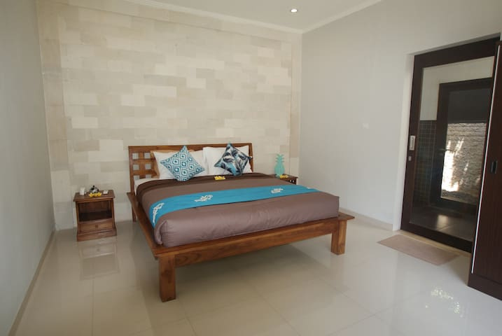 Bedroom No. 2, a spacious bedroom with comfortable mattress complete with a large ensuite bathroom with all amenities necessary including a bathtub and outdoor shower