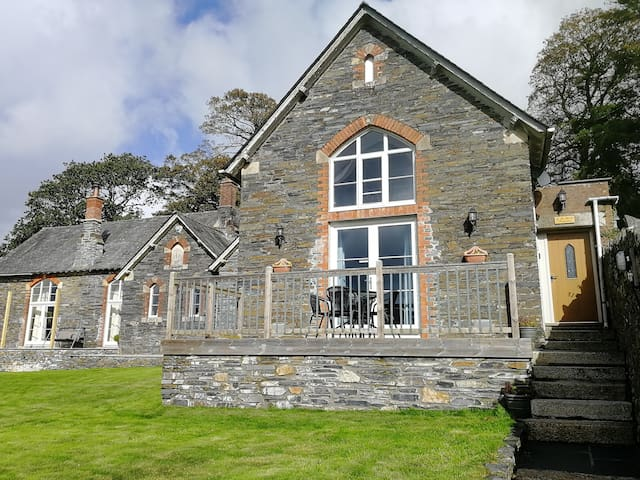 The Old Classroom; private front door and decked balcony with amazing panoramic views across the village, fields and woods.
