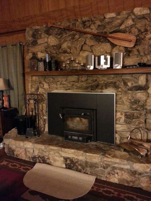 Fireplace ready for snowy nights.