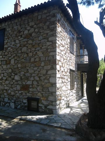 The cottage is old and made of stone with thick walls