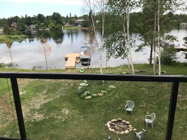 Back yard with fire pit and dock