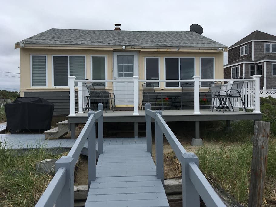 Deck and boardwalk with stairs to the beach