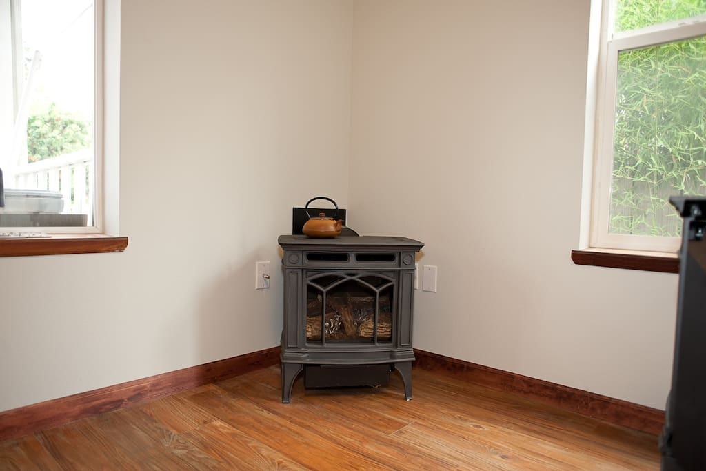 This gas stove will keep you cozy all winter long.  In the summer time it's off and the house stays cool with fans and open windows.