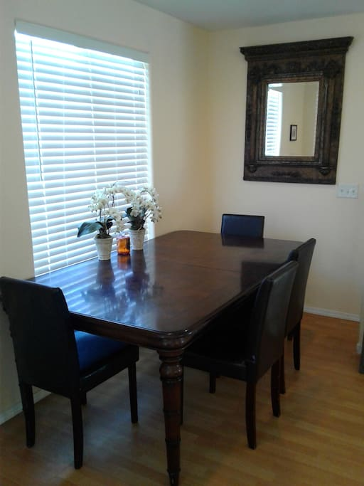 dining table in living room extends for big eating table.