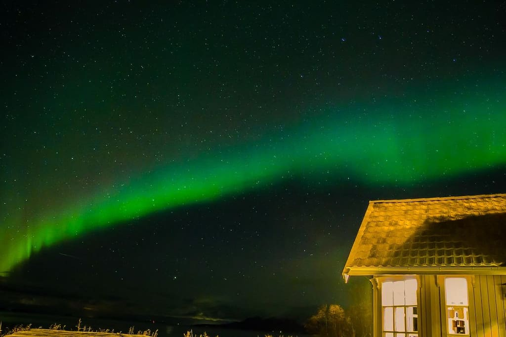 Aurora Borealis visiting Straumen Sea View, as seen from the patio Photo by: Jurjen Huisman - IG:mrjurjen