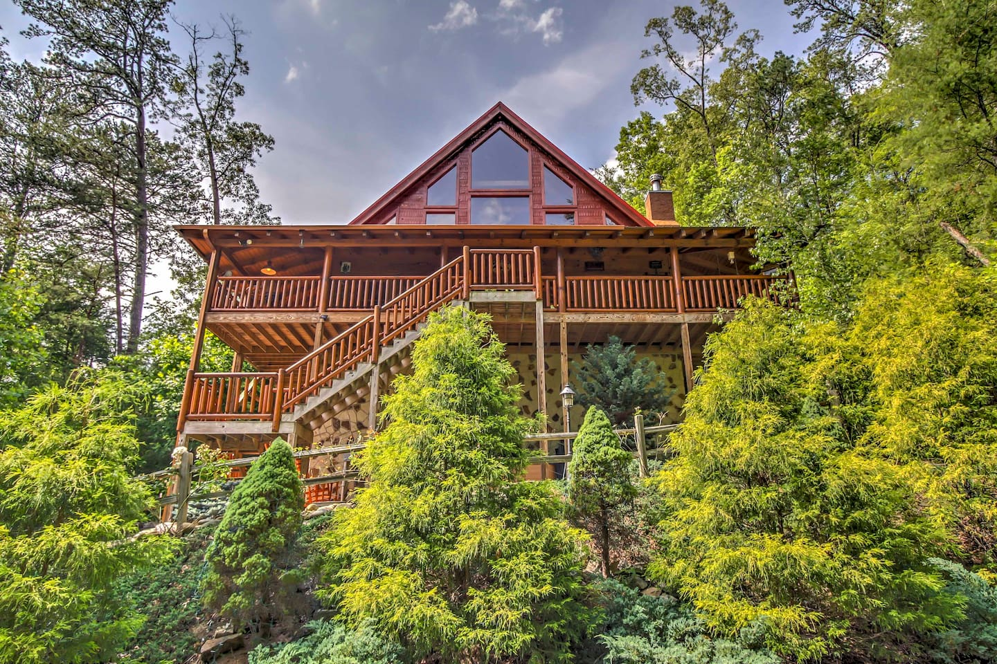 This large Gatlinburg vacation rental cabin is nestled in a beautiful forest.