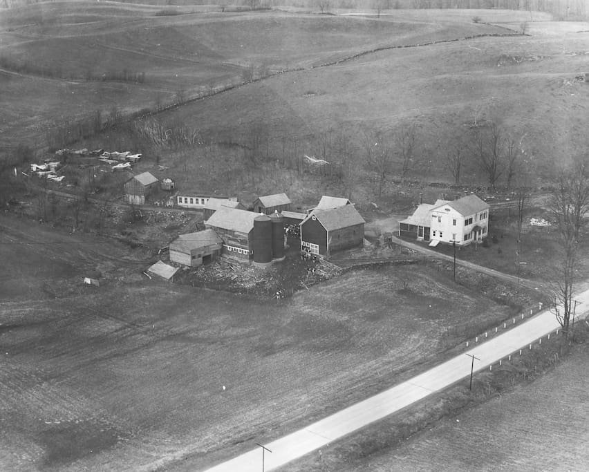 Aerial view of Owen Ensign's farm around 1932.  Note Route 22 repaving with rural electrification program.