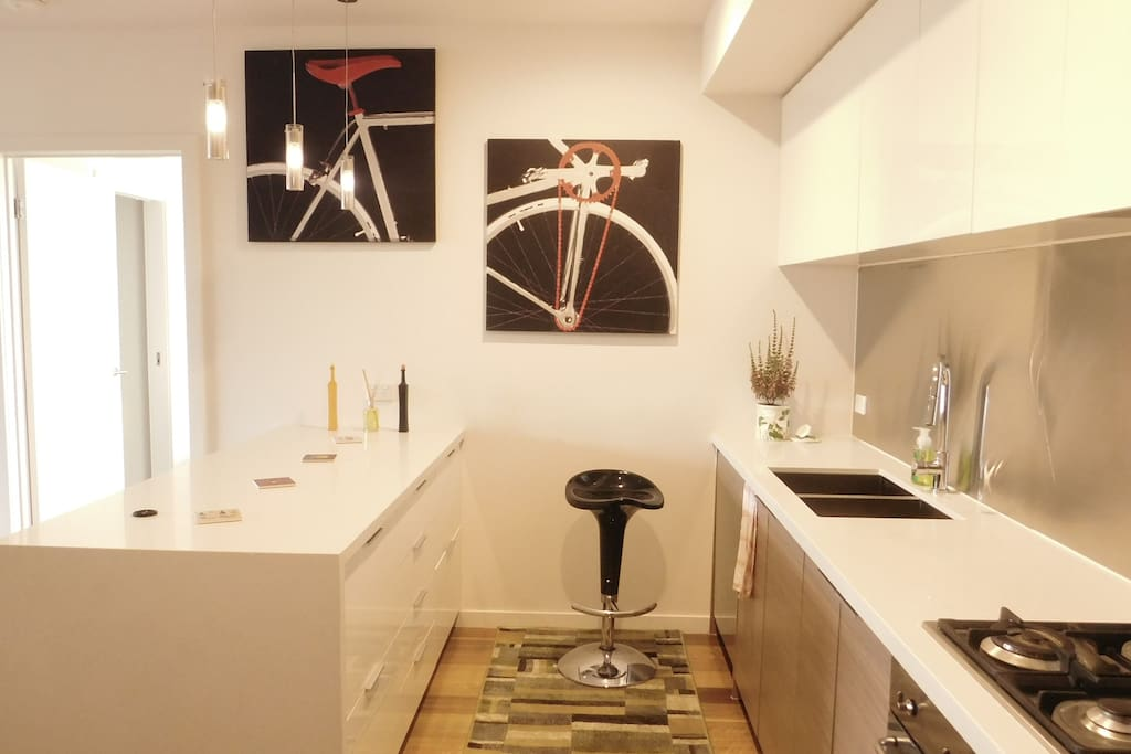 Modern open kitchen with bar table and stools