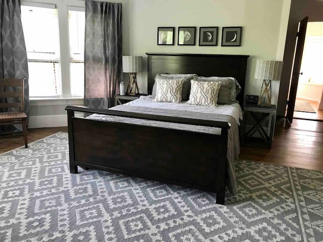 Large master bedroom with a queen bed and ensuite bathroom.