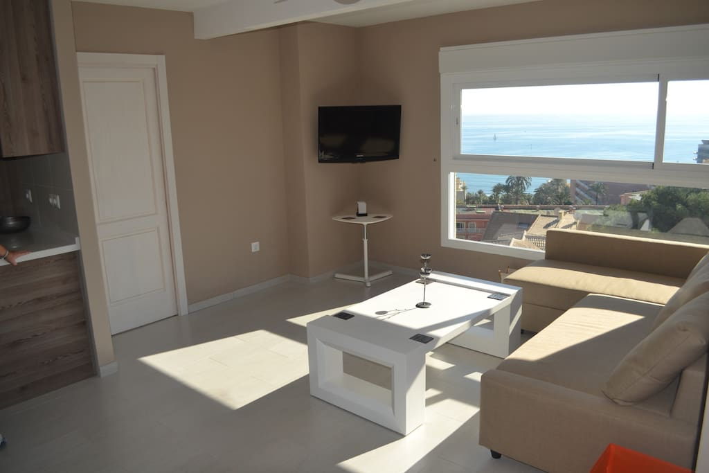 lounge area with sea and marina views, motorised window shutters.
