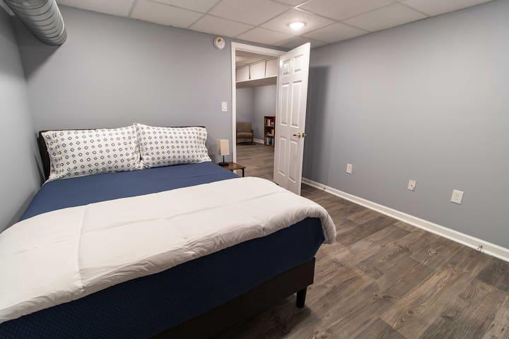 Bedroom 1, queen-sized bed with memory foam mattress.