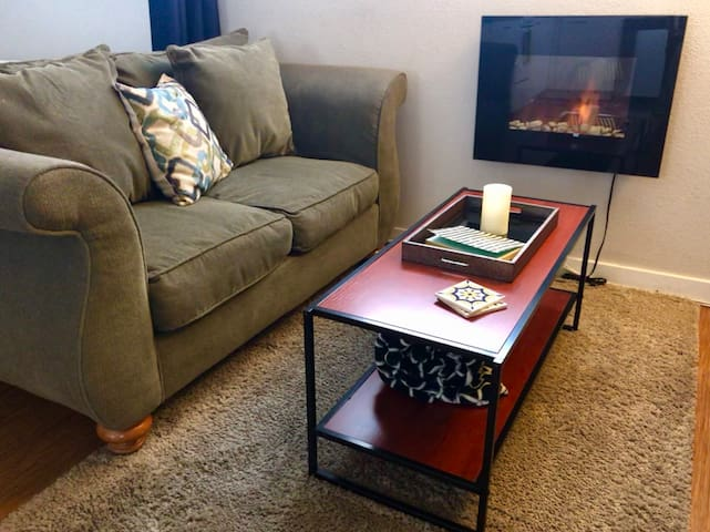 Comfy living space with fireplace and free wifi.