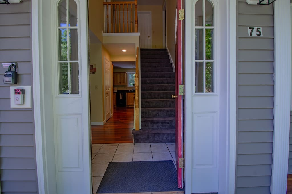 Entrance with stairs to second floor space.
