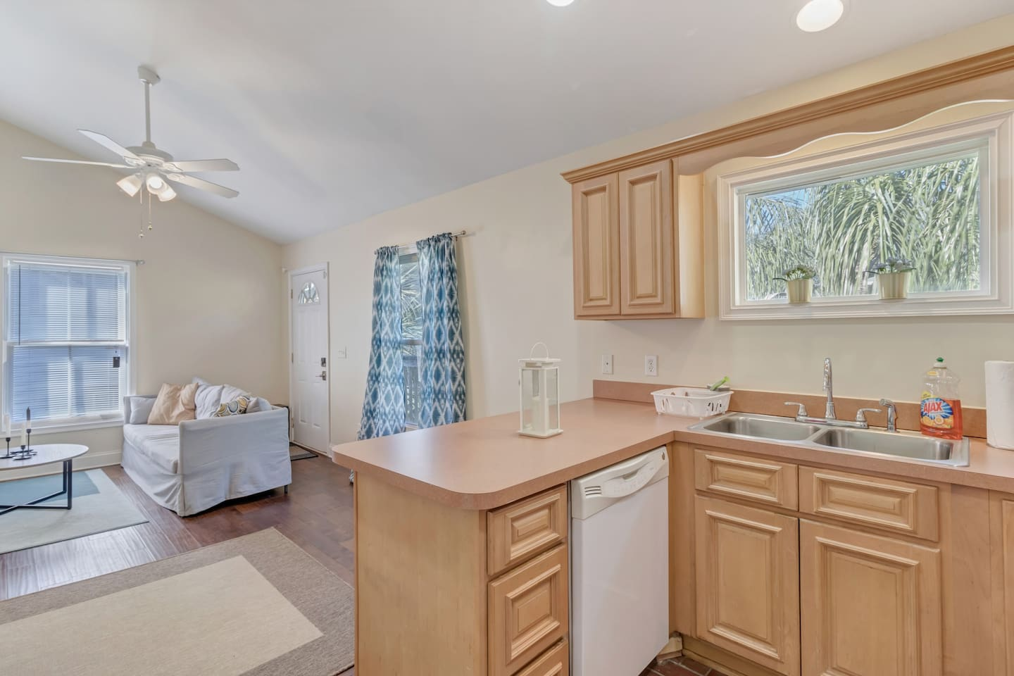 Large kitchen includes dishwasher, double sided sink with disposal, and lots of counter space