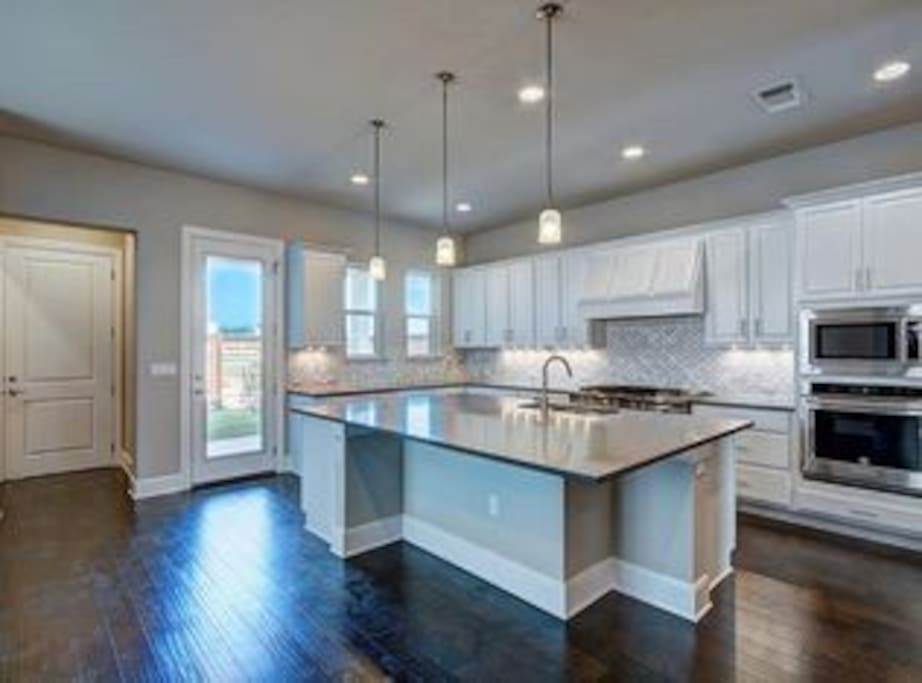 Huge Kitchen With Island Counter Top.