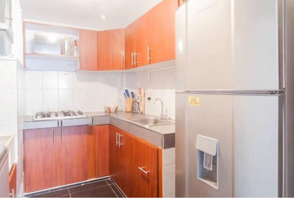 Enjoy cooking?  Relax and Save Money with FULLY EQUIPPED   KITCHEN with microwave, fridge, stove, crockery, cutlery, pots, sartens, electric Coffe maker, blender, glassware and water filter.  FREE use of Washer.