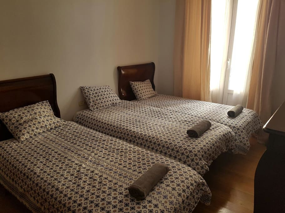 Second bedroom with three single beds