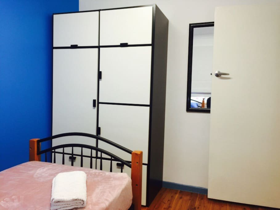 Excellent cupboard space and large mirror in your private room.