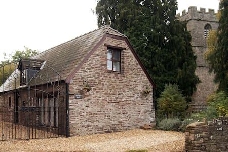 Penybont Barn, a cosy riverside barn conversion